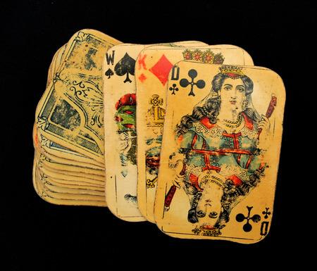 Vintage playing cards deck at black background