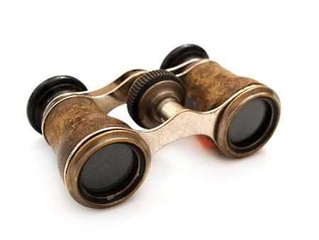 Antique brass binoculars at white background Standard-Bild