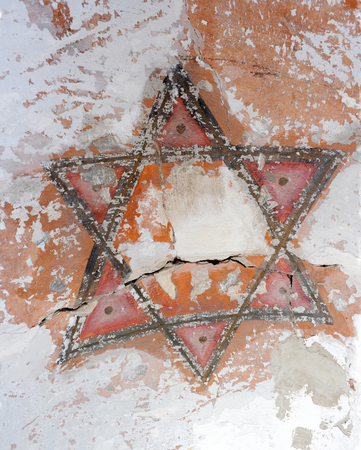 Six-pointed jewish star painted on a wall