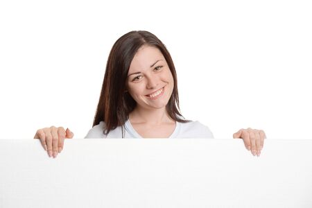 Girl behind a large blank white sheet of paper