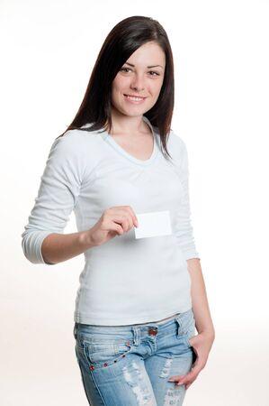 Pretty girl holding empty white visiting card Standard-Bild