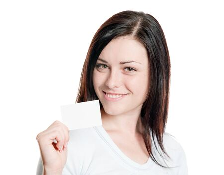 Closeup portrait of pretty girl displaying empty visiting card Standard-Bild