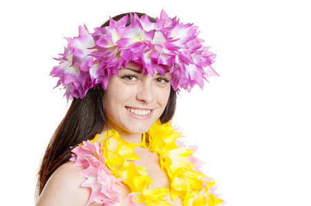 Pretty smiling girl in a hawaiian wreath portrait