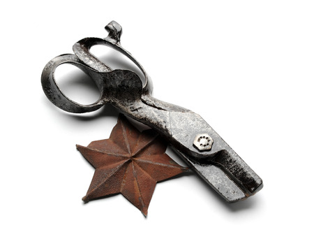 Retro metal scissors and six-pointed star