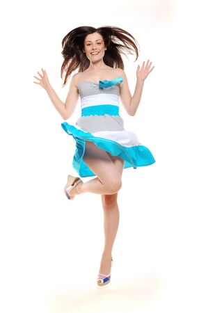 Beautiful excited jumping girl in summer dress Standard-Bild