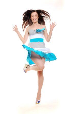 Beautiful excited jumping girl in summer dress Standard-Bild