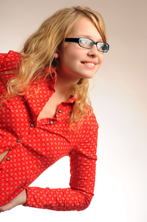 leaned: Pretty blonde girl in glasses leaned and looking sideways