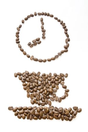 A cup of coffee and clock made from beans Stock Photo