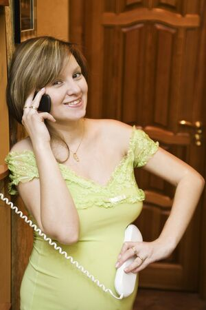 Young Pregnant woman talking with her child by phone photo