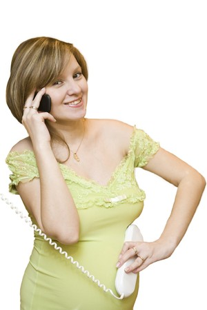 Young Pregnant woman talking with her child by phone