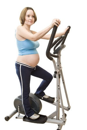 Yuong pregnant woman and gym fitness apparatus