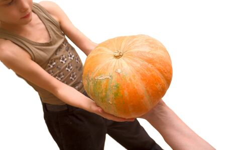 Young boy and big pumpkin in hands Stock Photo