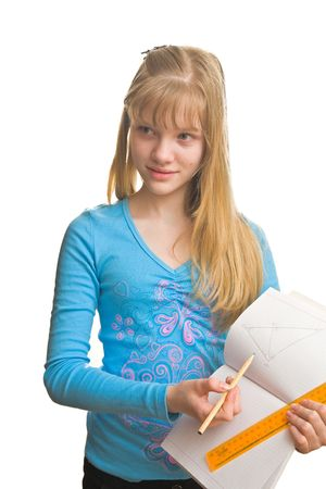 Beautiful blonde girl in blue dress hold pencil, rule and copybook