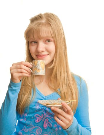 Young blonde lady with a cup in her hand photo