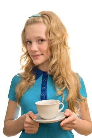 Beauty young blonde lady look at camera with cup of coffee photo