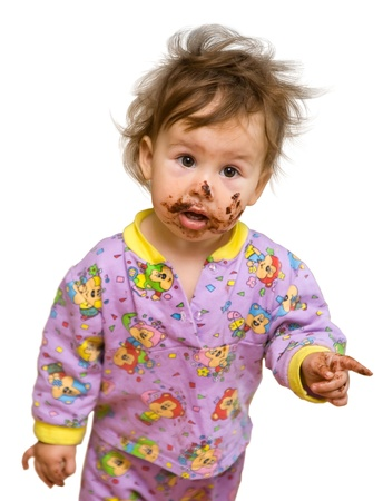 Beautiful baby with chocolate dirty face isolated on white show finger