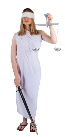 Young woman with balance and sword as Themis the godness Stock Photo - 12235879