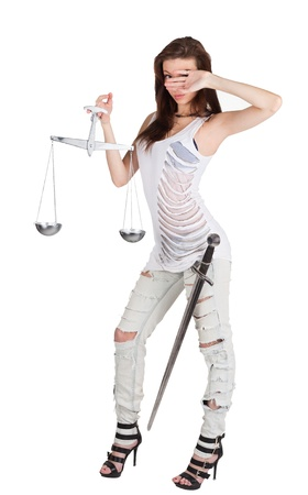 themis: Young woman with balance and sword as Themis the godness  Stock Photo