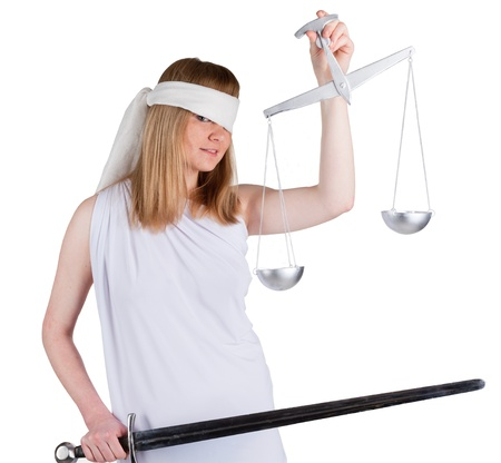 Beauty woman in white dress with a balance and a sword looking to you