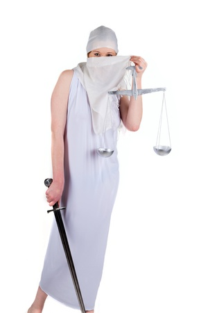 Beauty woman in muslim dress with a balance and a sword stay
