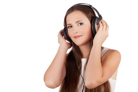 Girl listen and enjoyment music in headphones