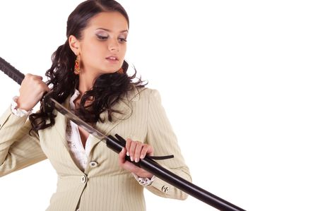 Office Samurai: The young woman in a business two-piece with Samurai a sword