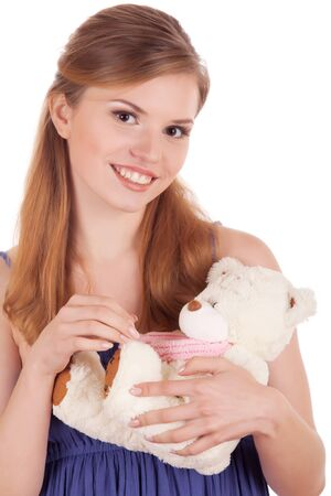 smiling girl with white teddy bear in hands Stock Photo - 9938629