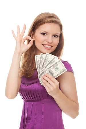Woman holding 500 dollars and showing sign OK isolated on white background