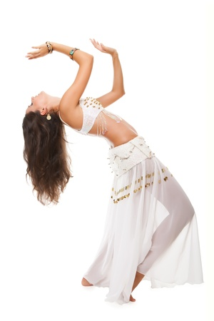 beautiful woman in the active arabic dance. studio shot.