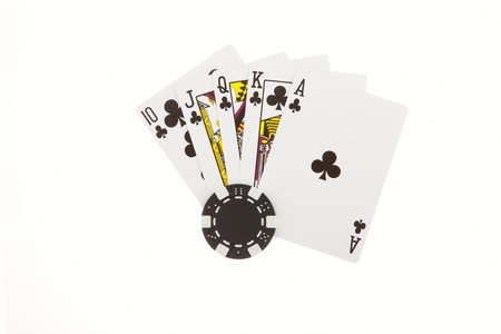 Royal Flush of clubs with poker chips isolated on the white background Stock Photo