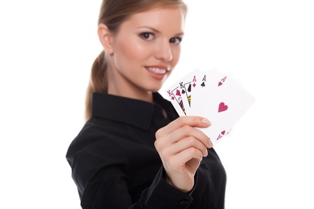 young woman holding in hand poker card with combination of Full House. in focus hand and poker card. photo