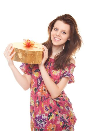 smiling young woman with gift gold box as heart isolated on white background Stock Photo - 10263346