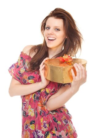 cheerful young woman with gift gold box as heart isolated on white background Stock Photo - 10263345
