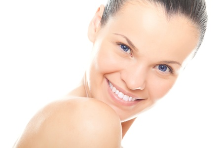 closeup face young woman with healthy clean skin and beautiful smile isolated over white background