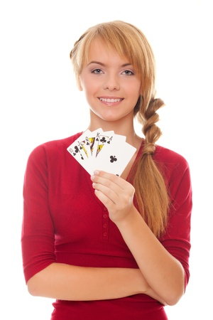 young woman holding in hand poker card with combination of Royal Flush of clubs isolated on the white background