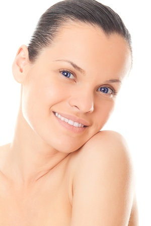 closeup face beautiful woman with healthy clean skin and teeth isolated over white background photo