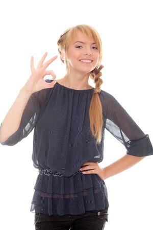 beautiful teenager showing sign okey isolated over white background Stock Photo - 10331428