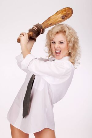 a cudgel: Angry woman with cudgel Stock Photo