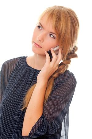 communicates: teenager communicates on cell phone. studio shoot. isolated on white.