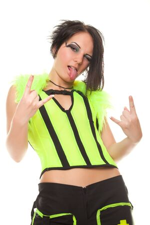 punk girl in bright clothes shows gesture stuck her tongue out on white background photo