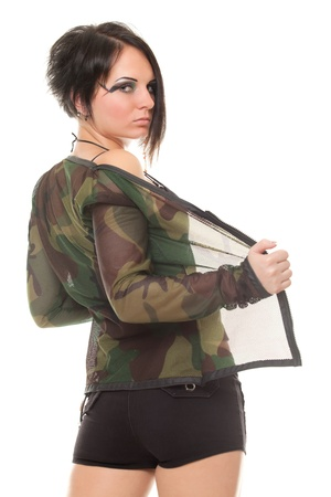 young woman in shorts and camouflage from the back on white background photo