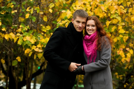 young love couple in against the backdrop of autumn trees