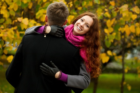 girl hugging her boyfriend with a smile of happiness Stock Photo