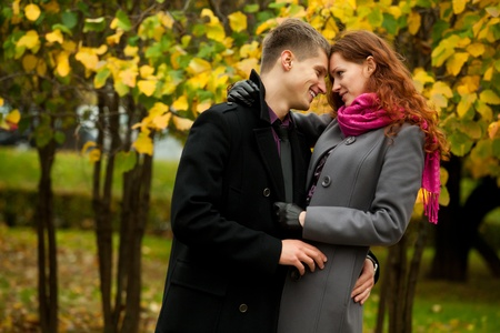 portrait of happy couple in autumn park photo