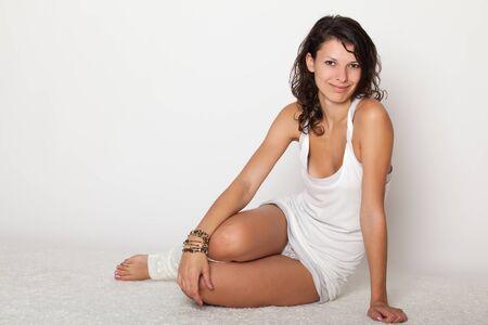 luxuriate: beautiful girl lying in white underwear and socks