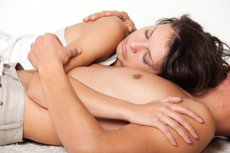 embraces: young woman is lying on his chest man. studio shots photography