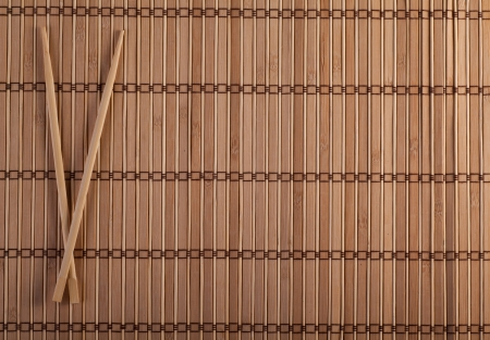 Two chopsticks on sushi mat background for menu Stock Photo - 15532613