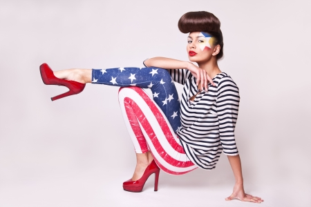 fashion model in american flag leggings with bright makeup photo