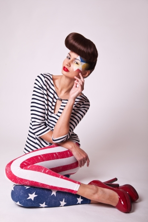 fashion portrait beautiful girl in american flag pants