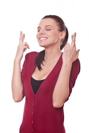 crossed fingers: beautiful smiling woman shows crossed fingers making wish Stock Photo